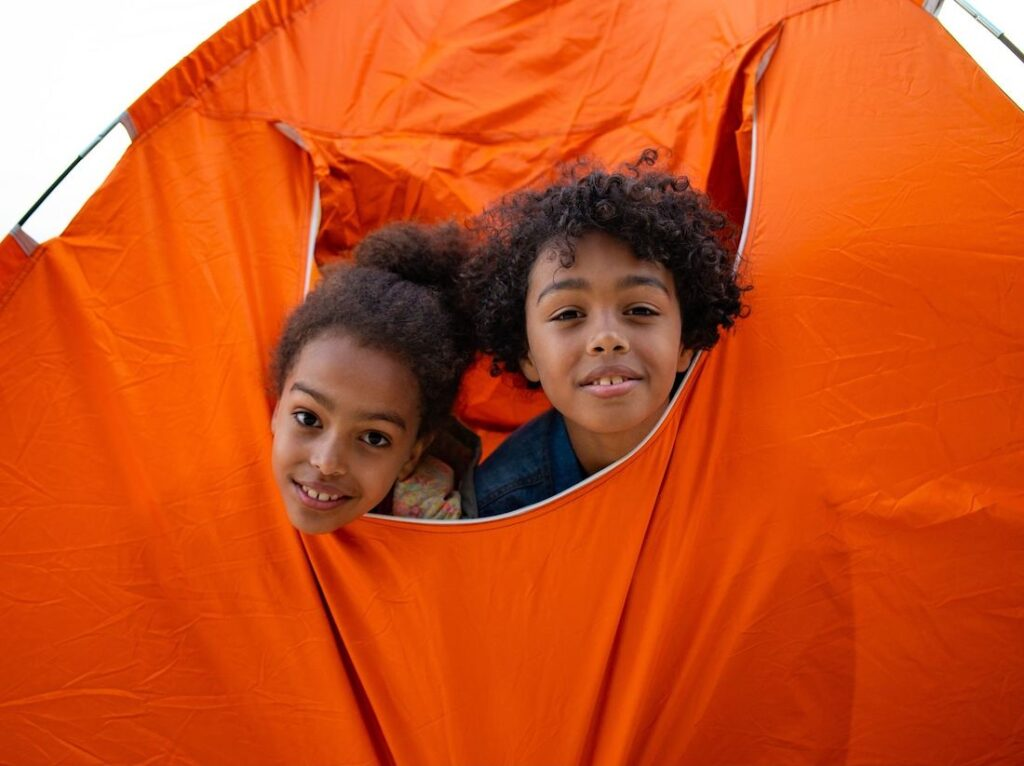 kids playing in a tent while camping