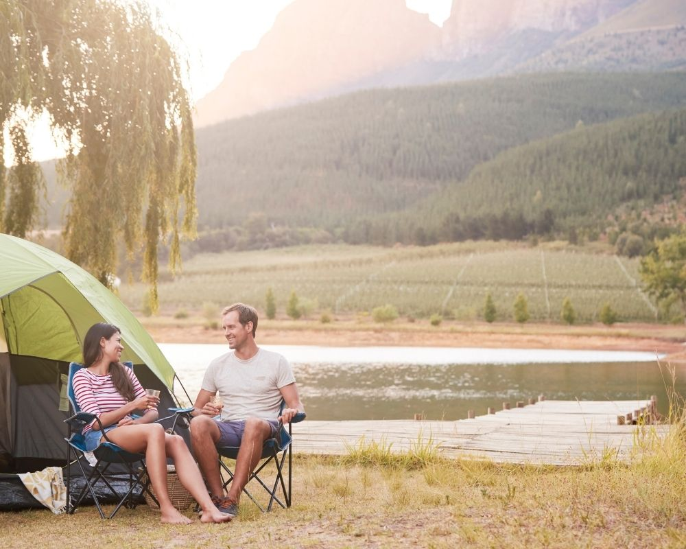 couple hanging out while camping