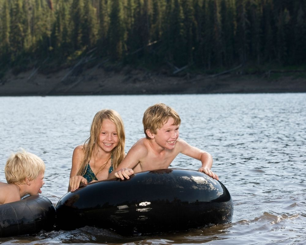 kids tubing in the water