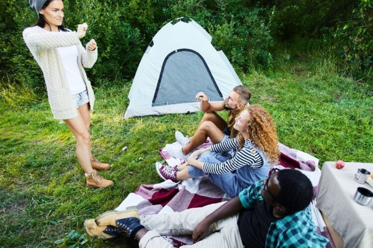 adults playing game camping